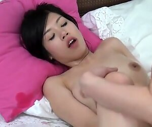 Oily Korean babe and skinny pervert have fun in bed