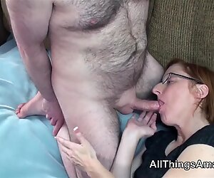 Mature glasses wearing redhead in stockings