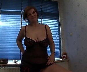 Big titted mother Desiree masturbates on bed