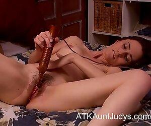 Natalia M masturbates with a toy