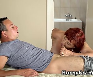 Old redhead gobbles cock