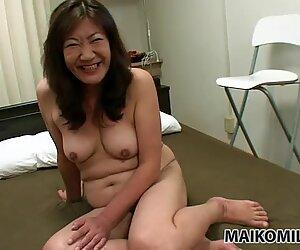 Chubby milf Michiko Okawa gets fingered and blows cock