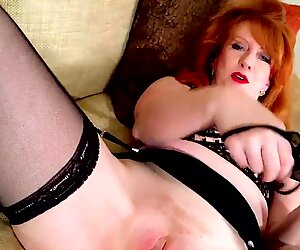 Busty redhead mature Red XXX toys her creamy pussy