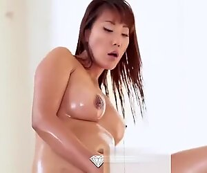 Busty Asian babe opens her legs after a sensual massage