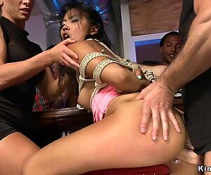 Tied Asian spanked and fucked in public